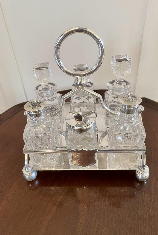 quality antique silver plated six bottle cruet set