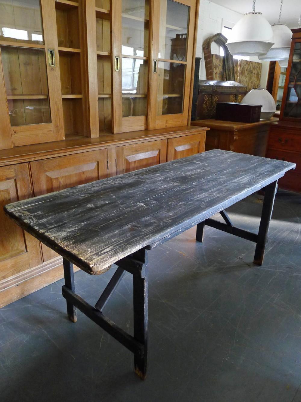 early 20th century ebonised folding trestle table