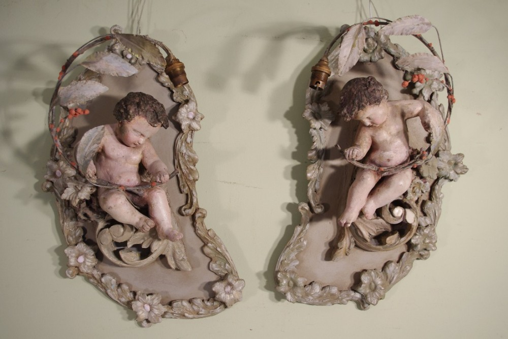 pair of french painted 'putti' wall lights