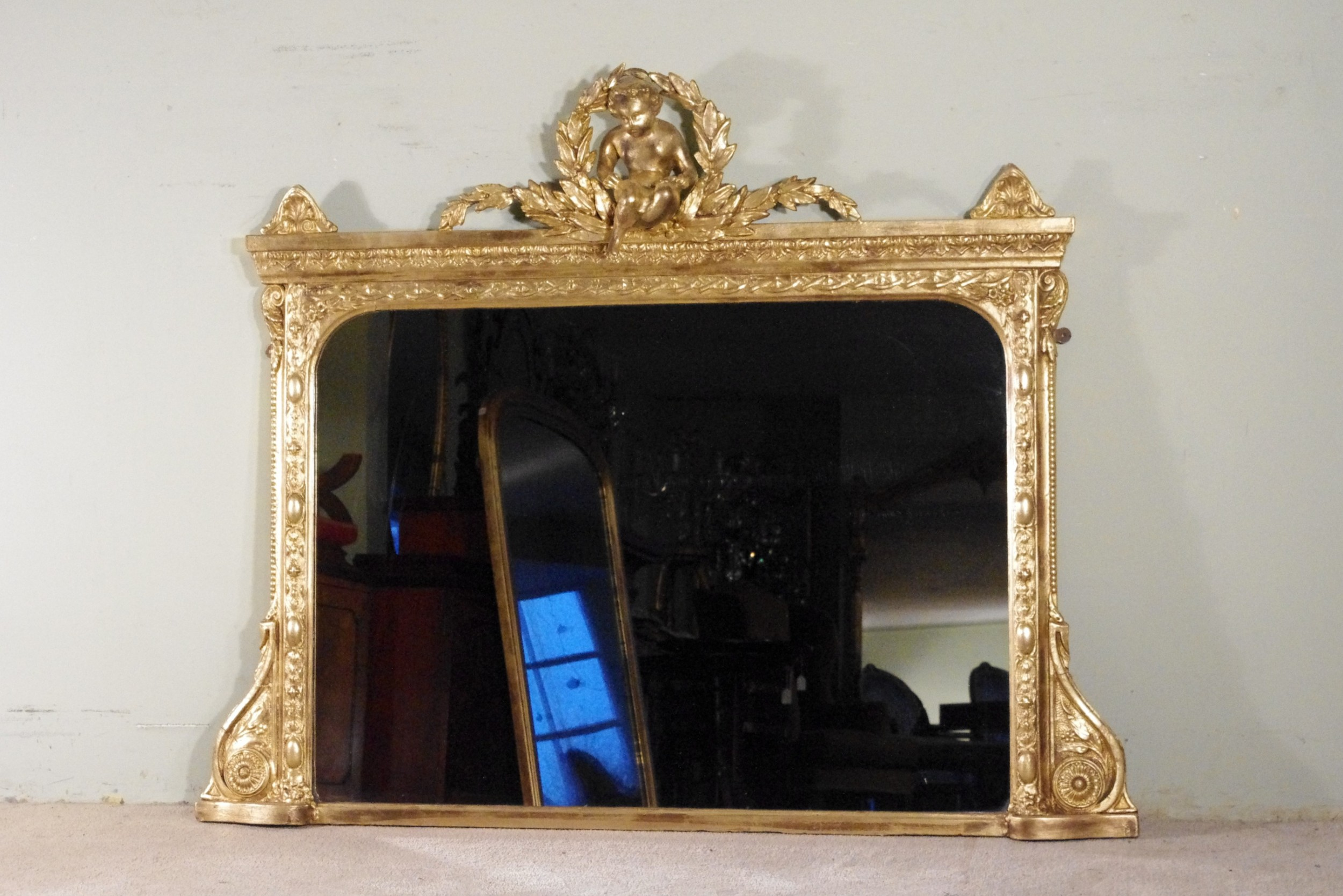 english victorian gilt large overmantle mirror with putto cresting