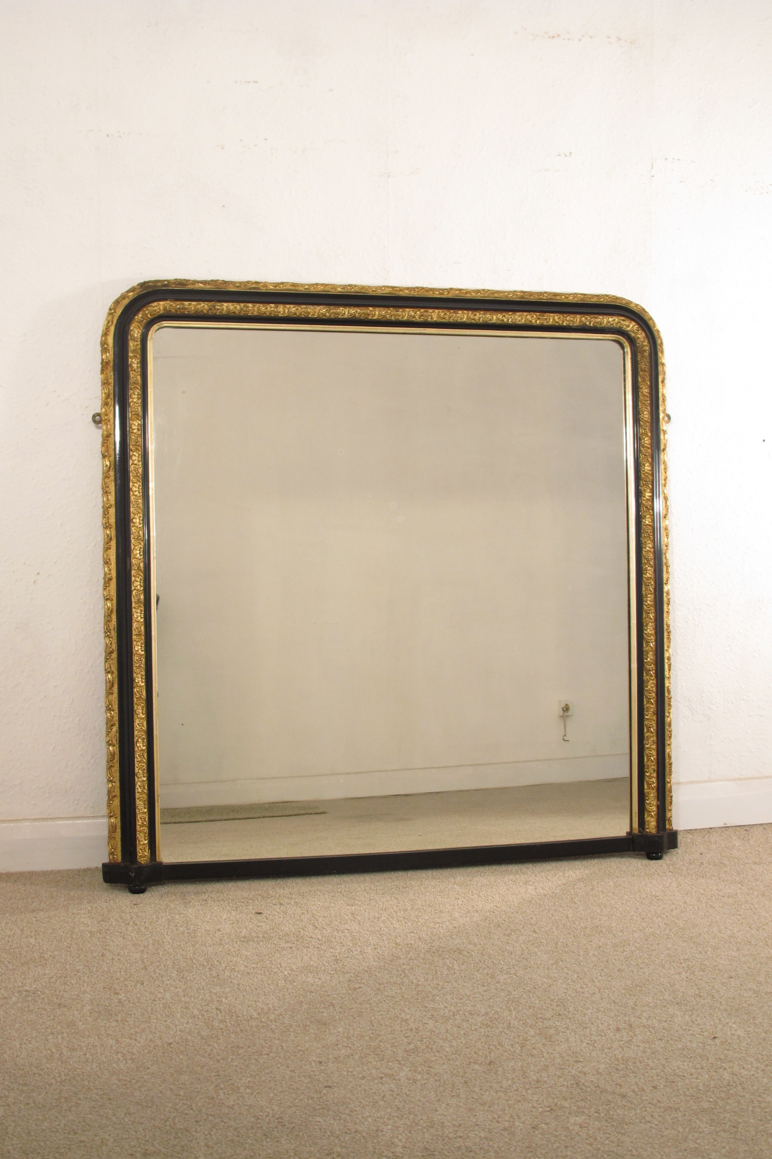 victorian ebonised and parcelgilt large overmantle mirror