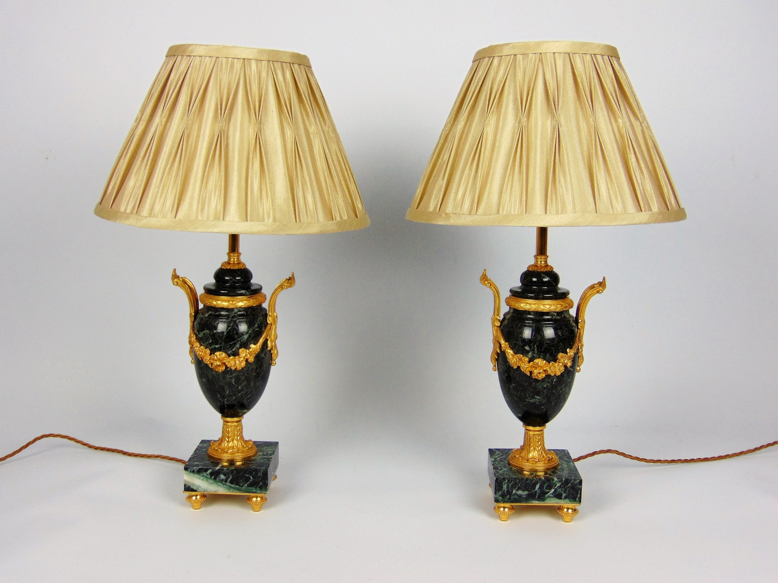 a fine pair of marble lamps