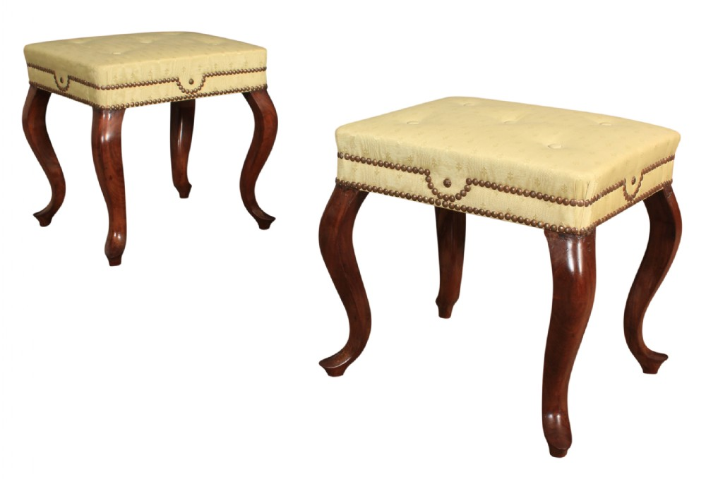 pair of mahogany footstools