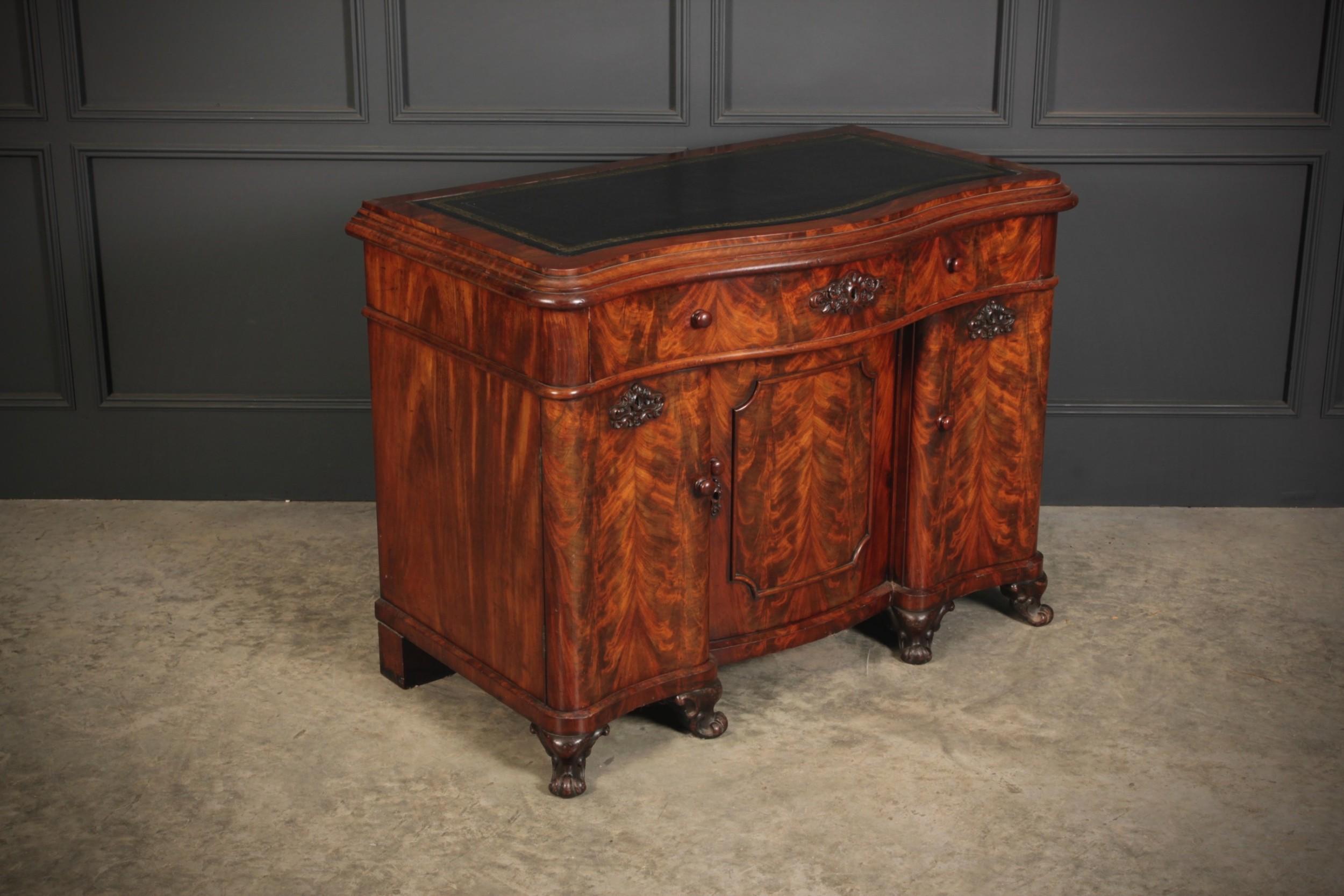 flame mahogany serpentine shaped desk