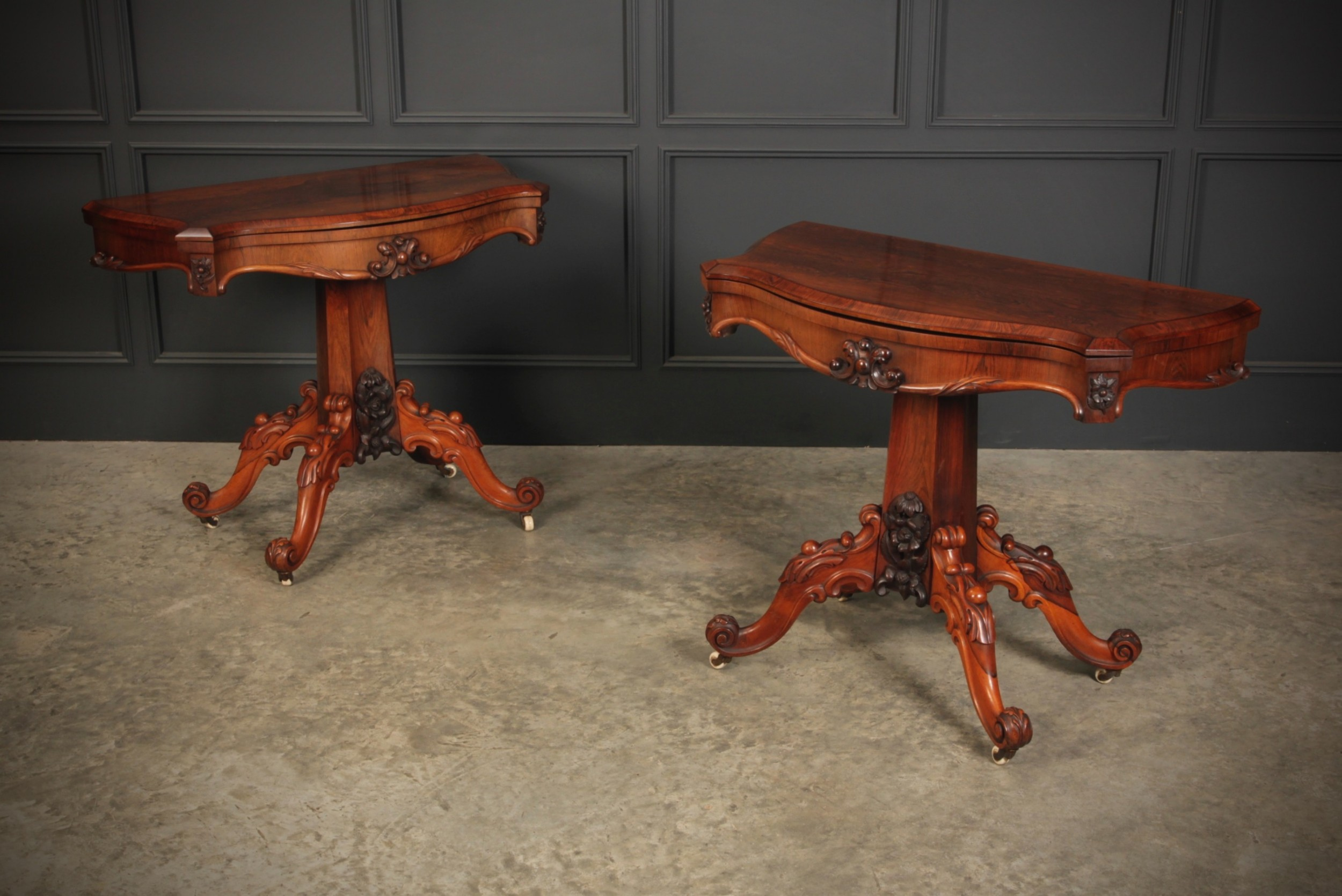 pair of rosewood serpentine card tables