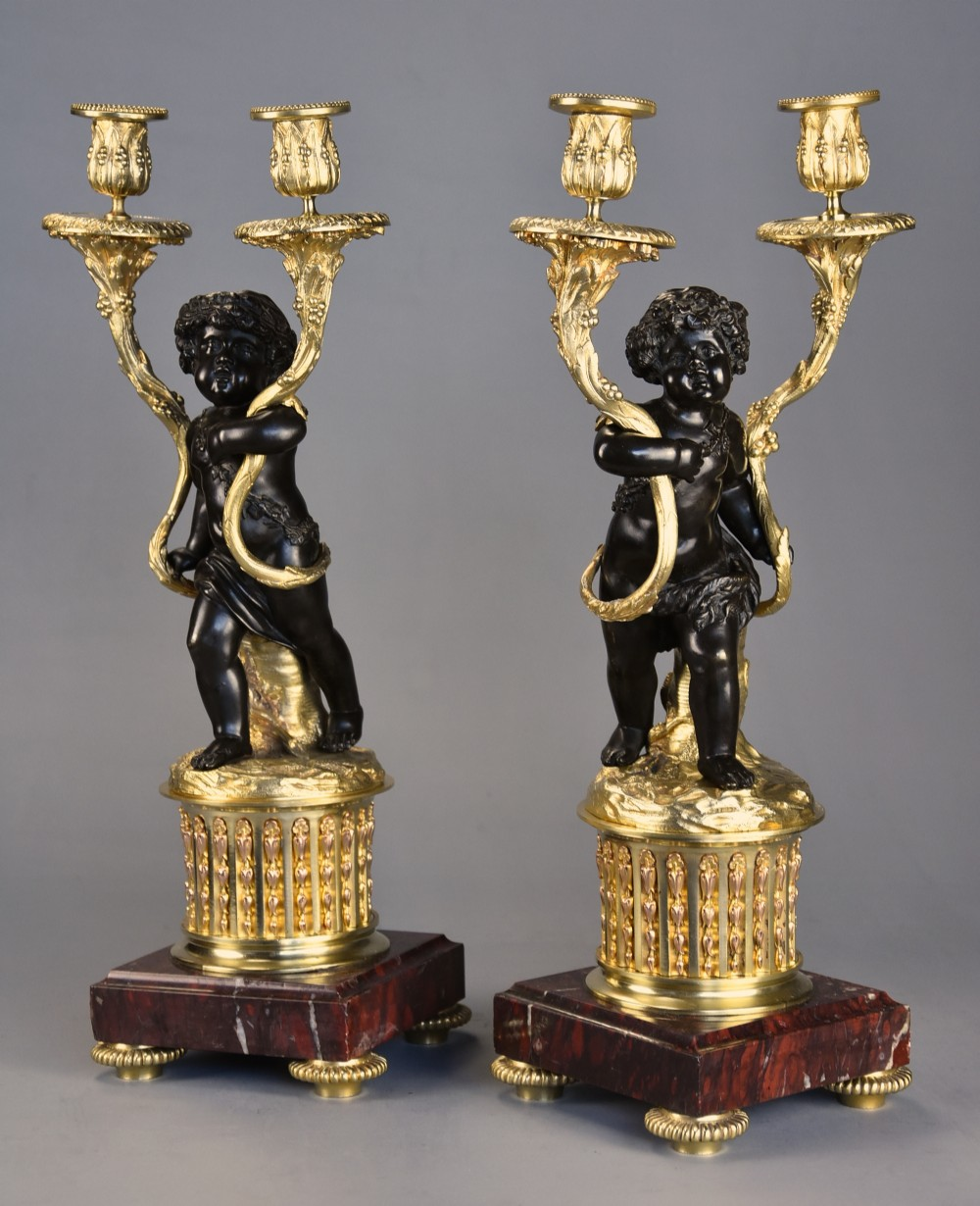pair of fine quality french late 19th century ormolu bronze candelabra in the manner of clodion