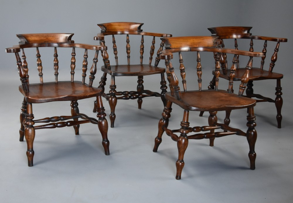 set of four mid 19th century beech elm smokers bow windsor or captains chairs