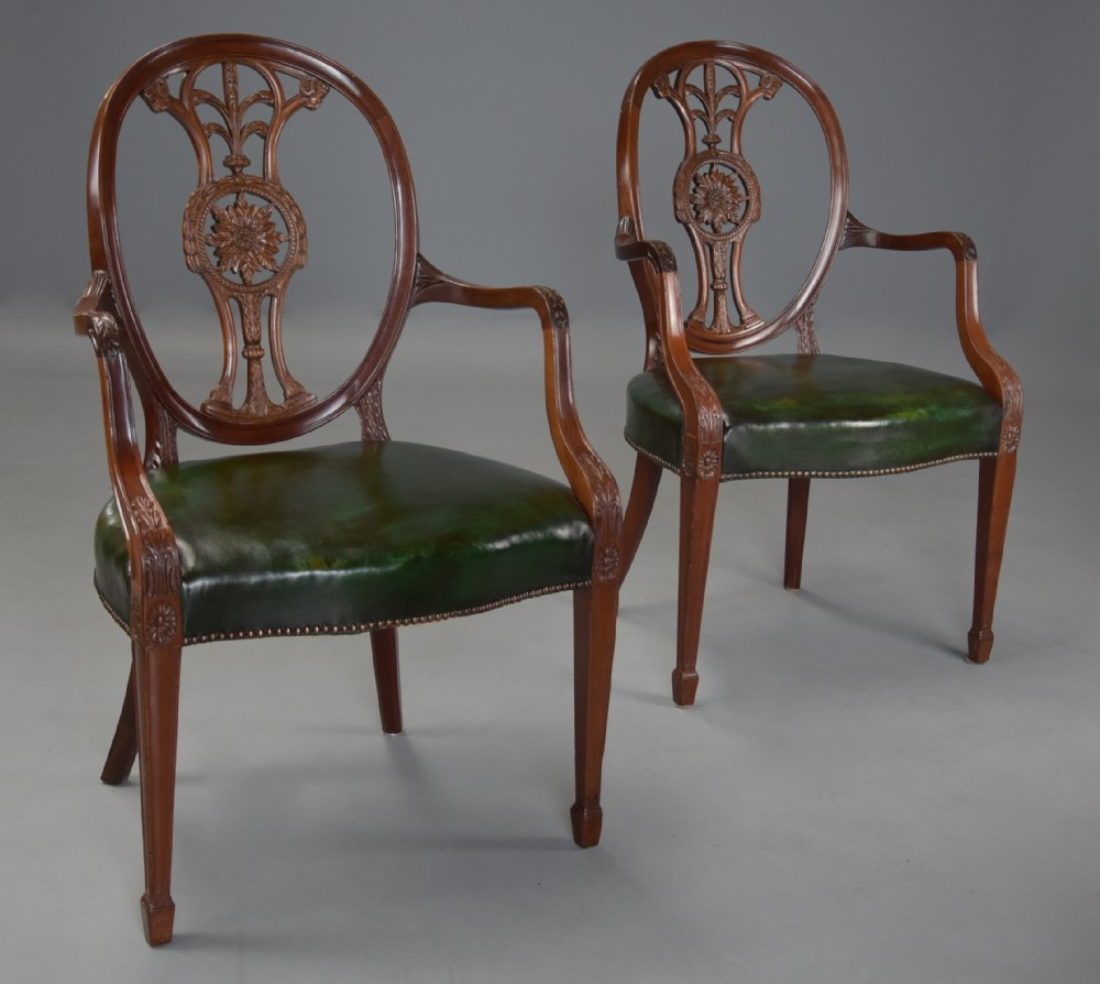 pair of late 19th century hepplewhite style mahogany oval back open armchairs