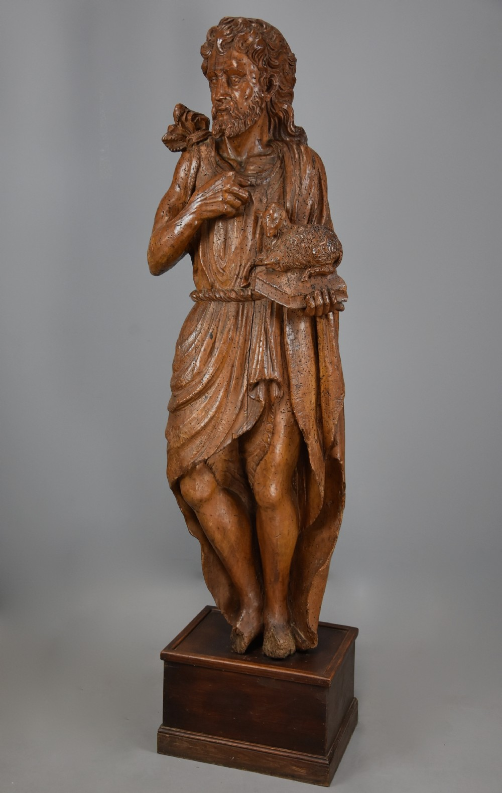 large continental mid 16th century carved limewood figure of st john the baptist