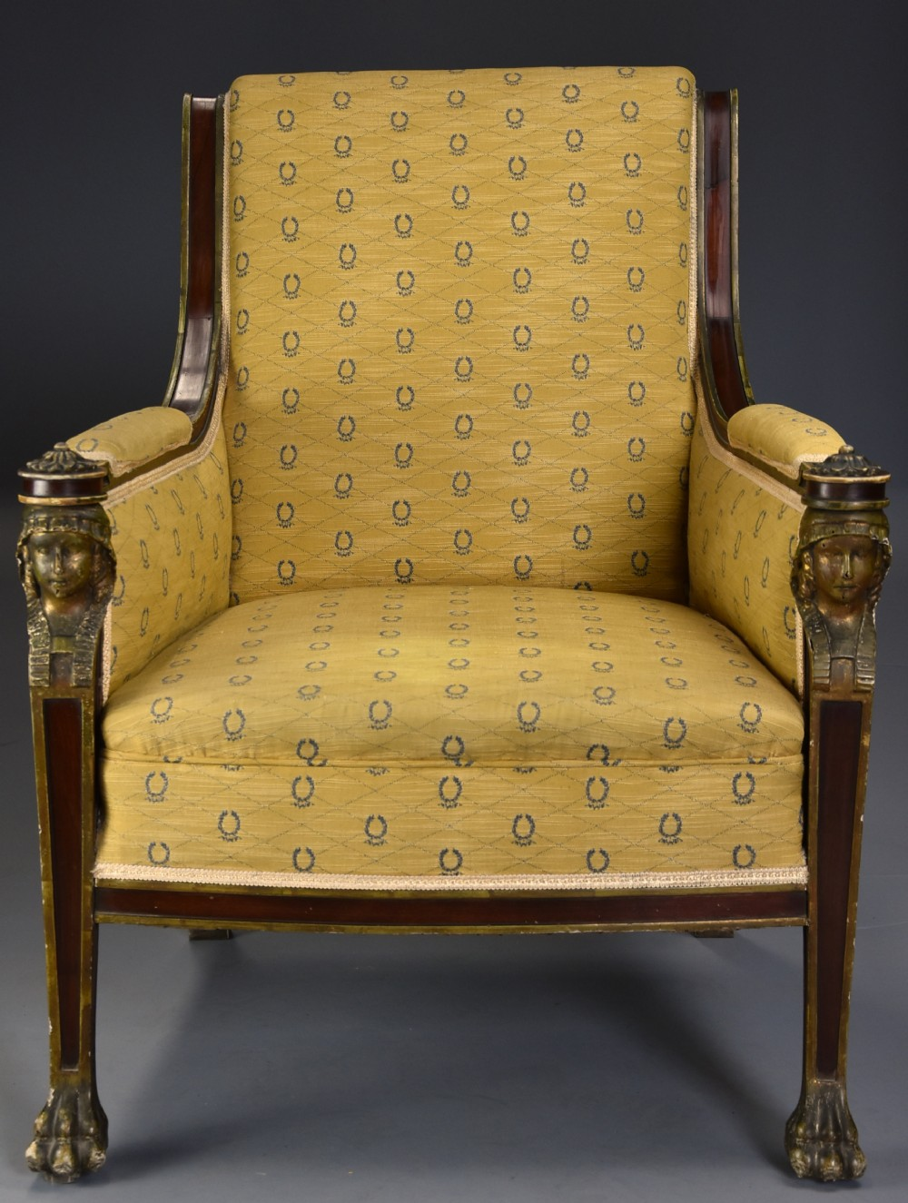 highly decorative early 20th century french empire style mahogany armchair