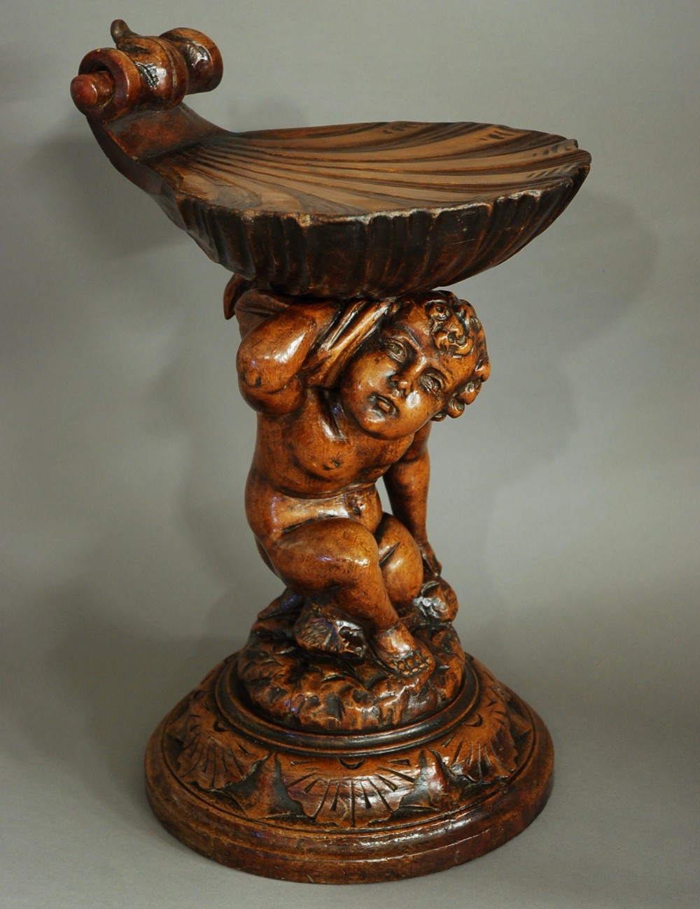 highly decorative venetian late 19th century pine putto and shell grotto stool