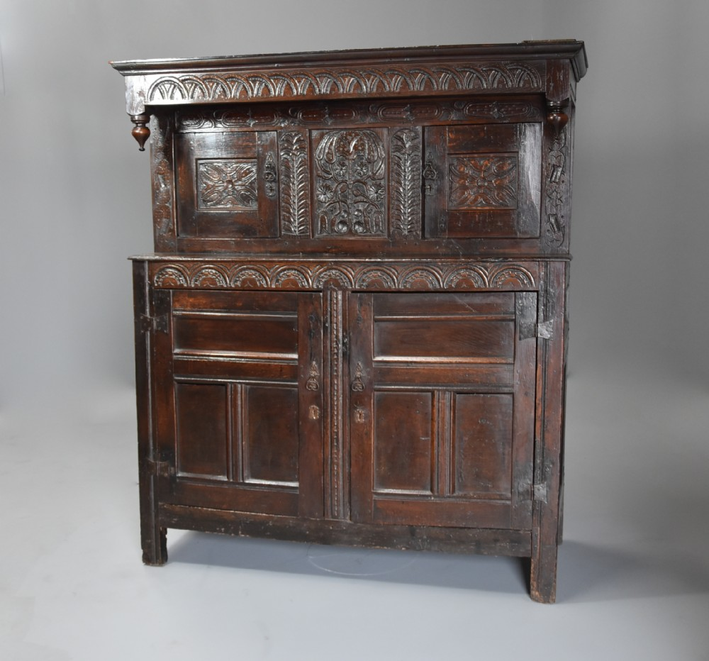 wonderful example of a mid 17thc carved oak press cupboard with superb original patina