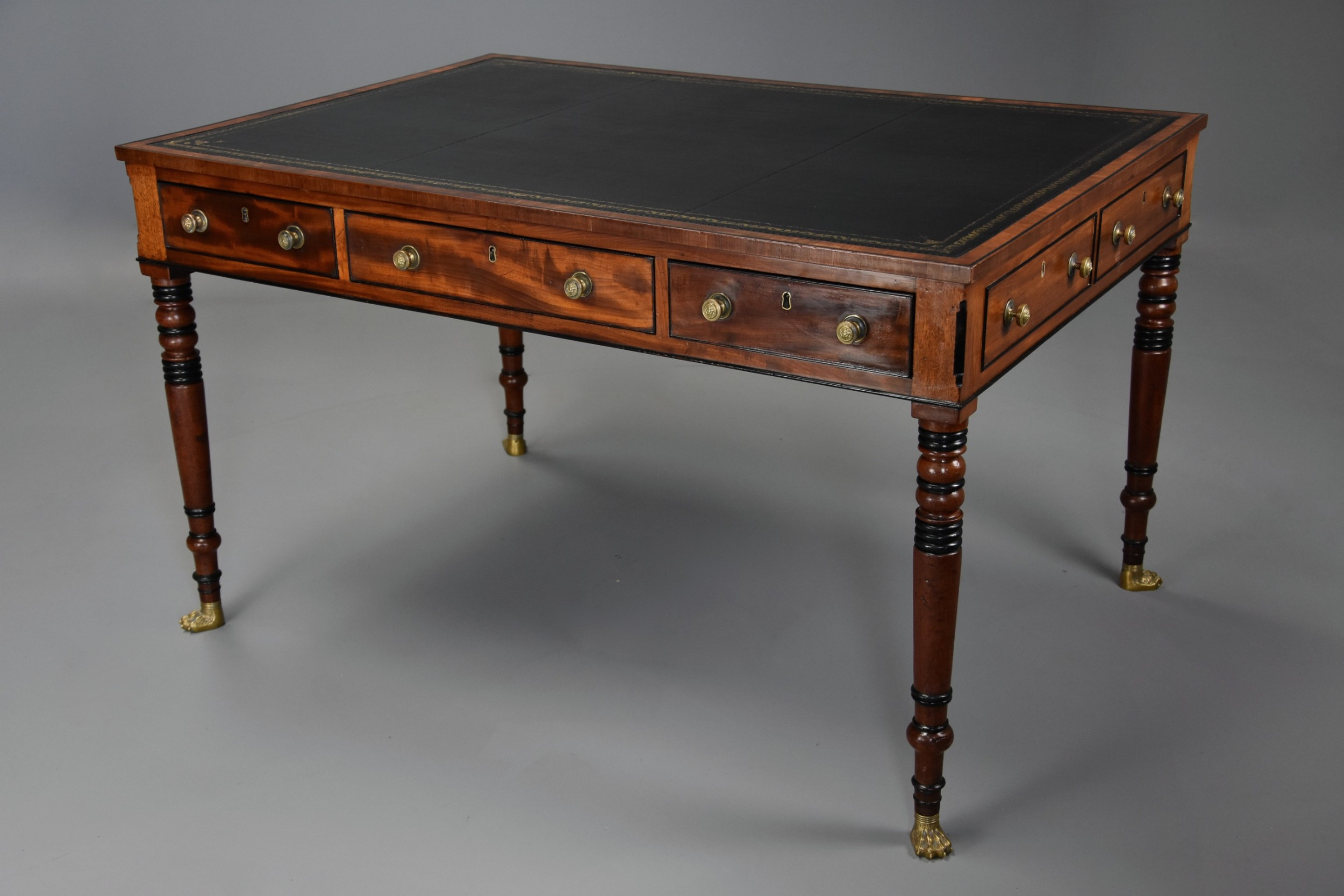 large early 19th century regency six drawer writing table of fine faded patina