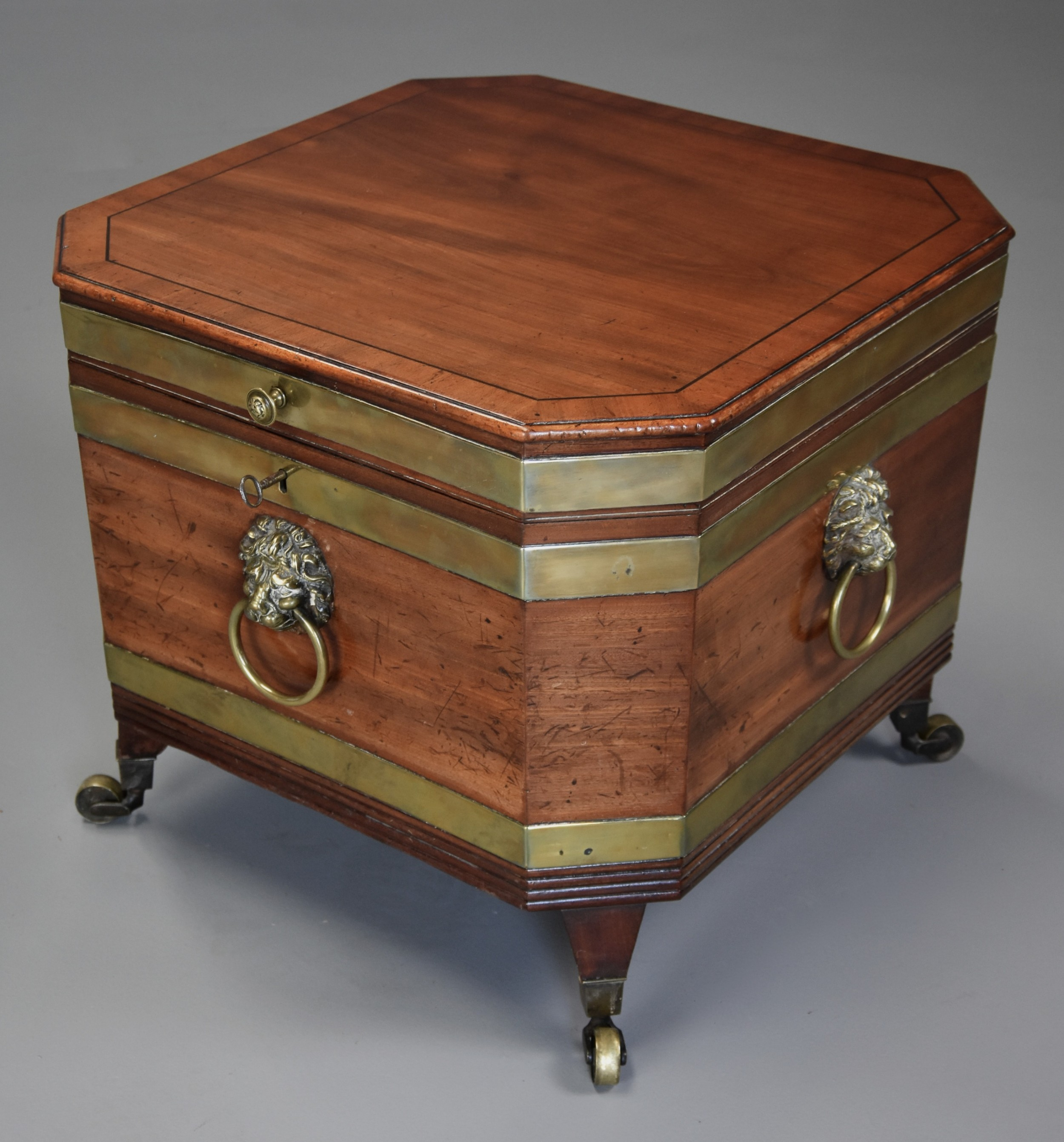 early 19th century regency mahogany brass bound cellarette or wine cooler of excellent patina