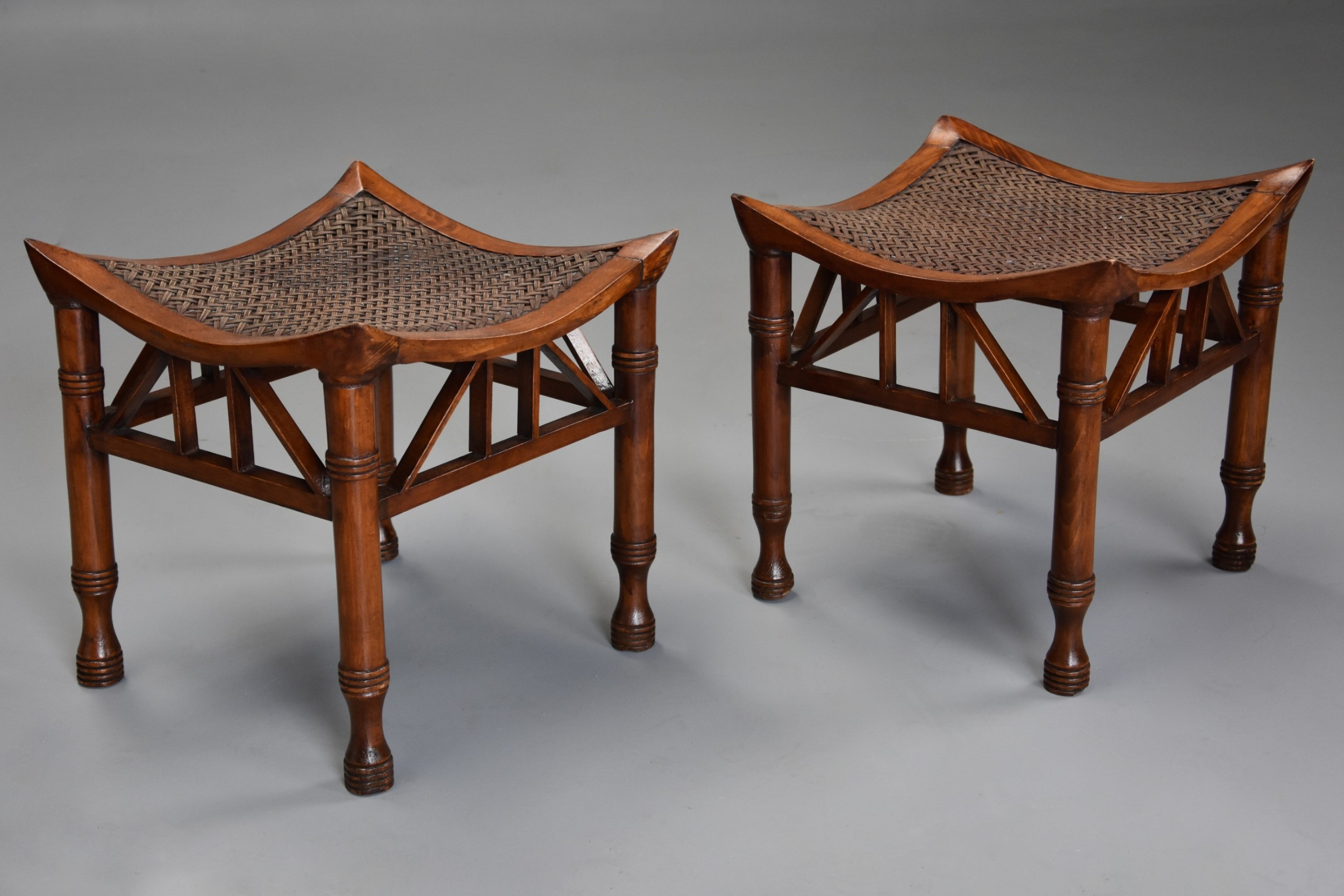 pair of early 20th century walnut thebes stools designed by liberty co