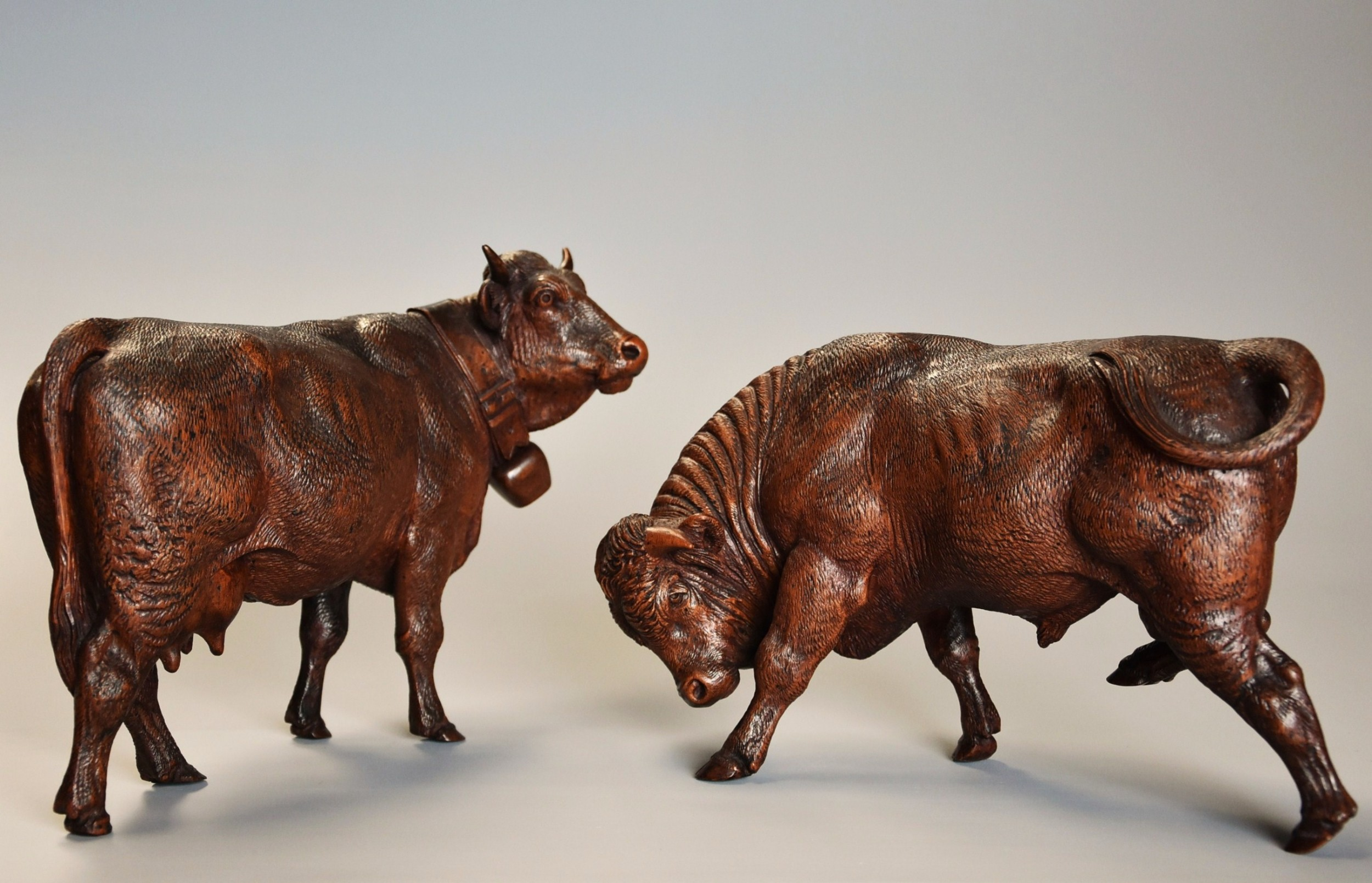 pair of finely carved late 19th century linden wood black forest cows possibly by the huggler family