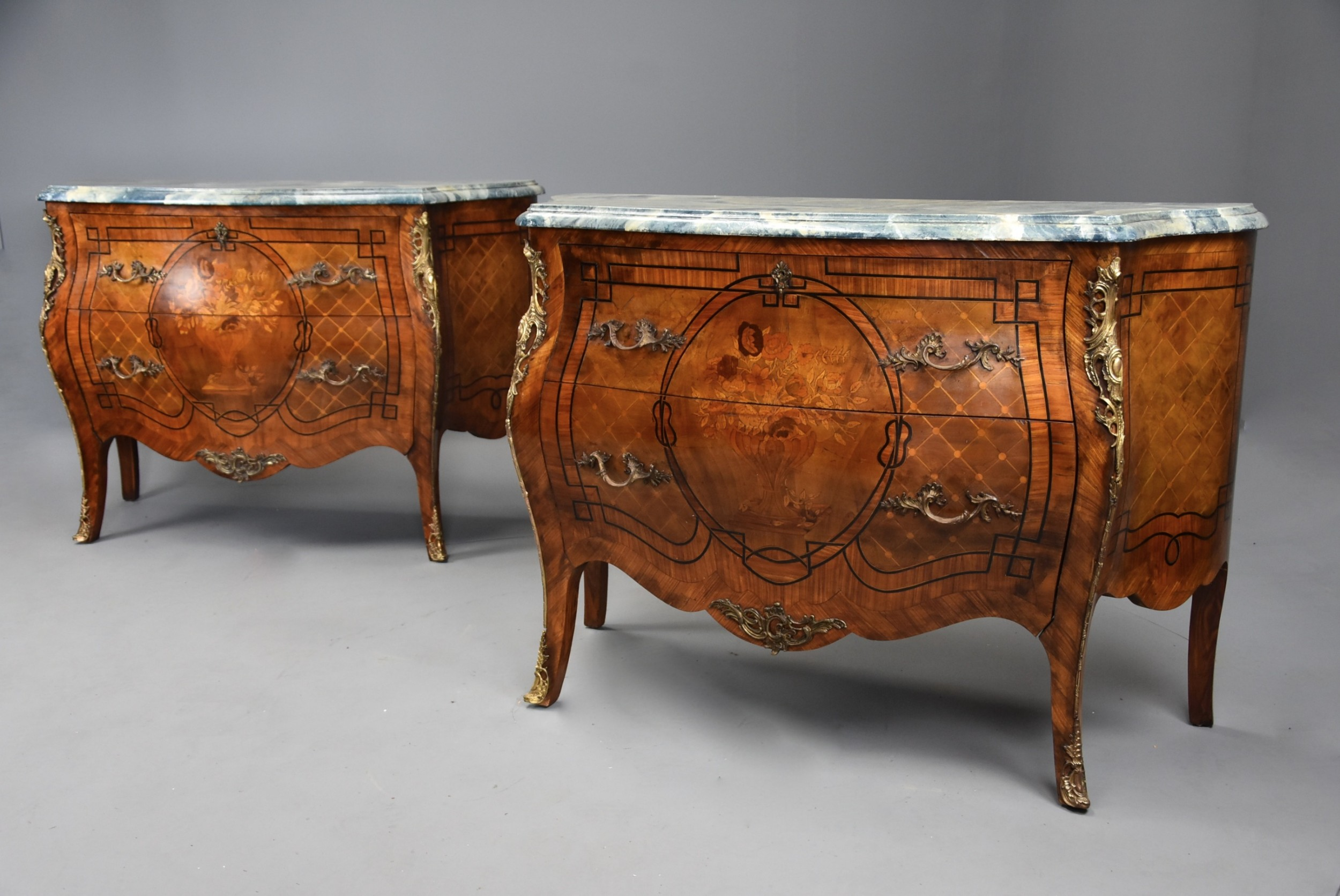 pair of french early 20th century highly decorative kingwood bombe commodes