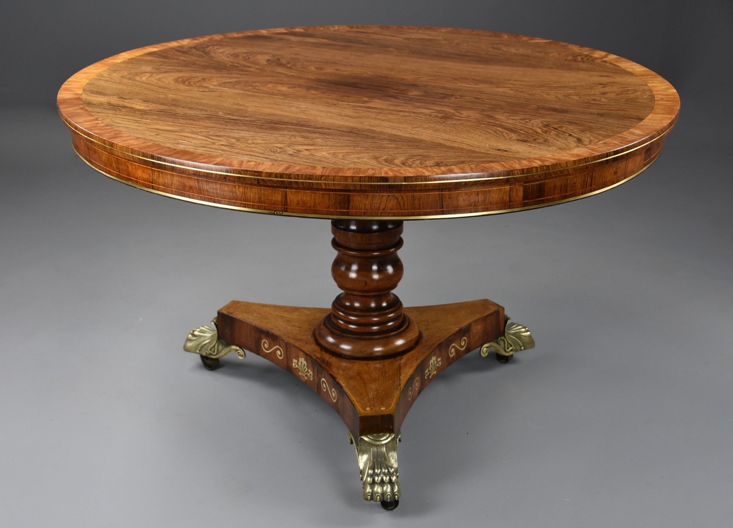 fine quality regency rosewood tilt top centre table of fine patina