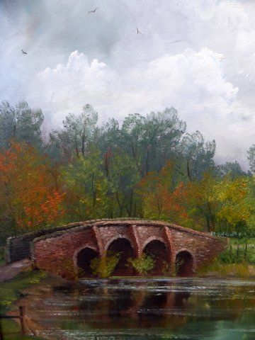 river landscape oil painting with stone bridge presented in original decorative swept frame 26 x 22 ins