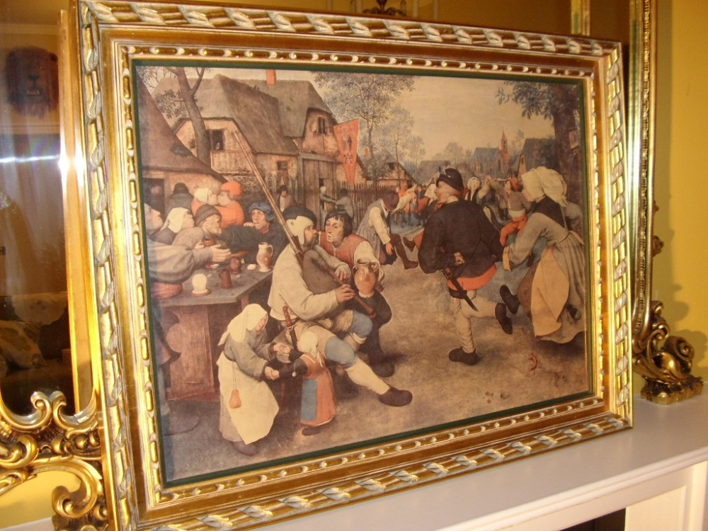 oileograph print on canvas of dutch tavern scene depicting a 17th century genre scene in heavy carved wooden gilt frame