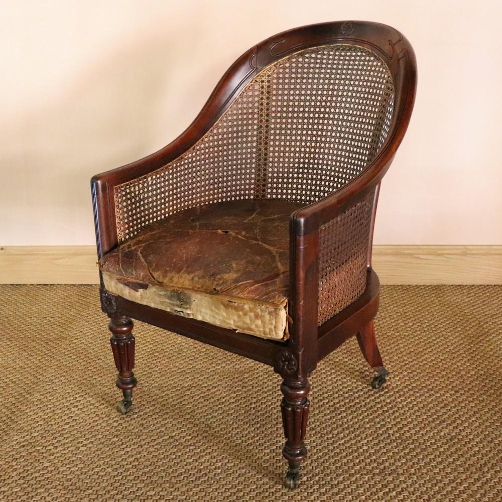 regency mahogany bergere armchair attributed to george bullock