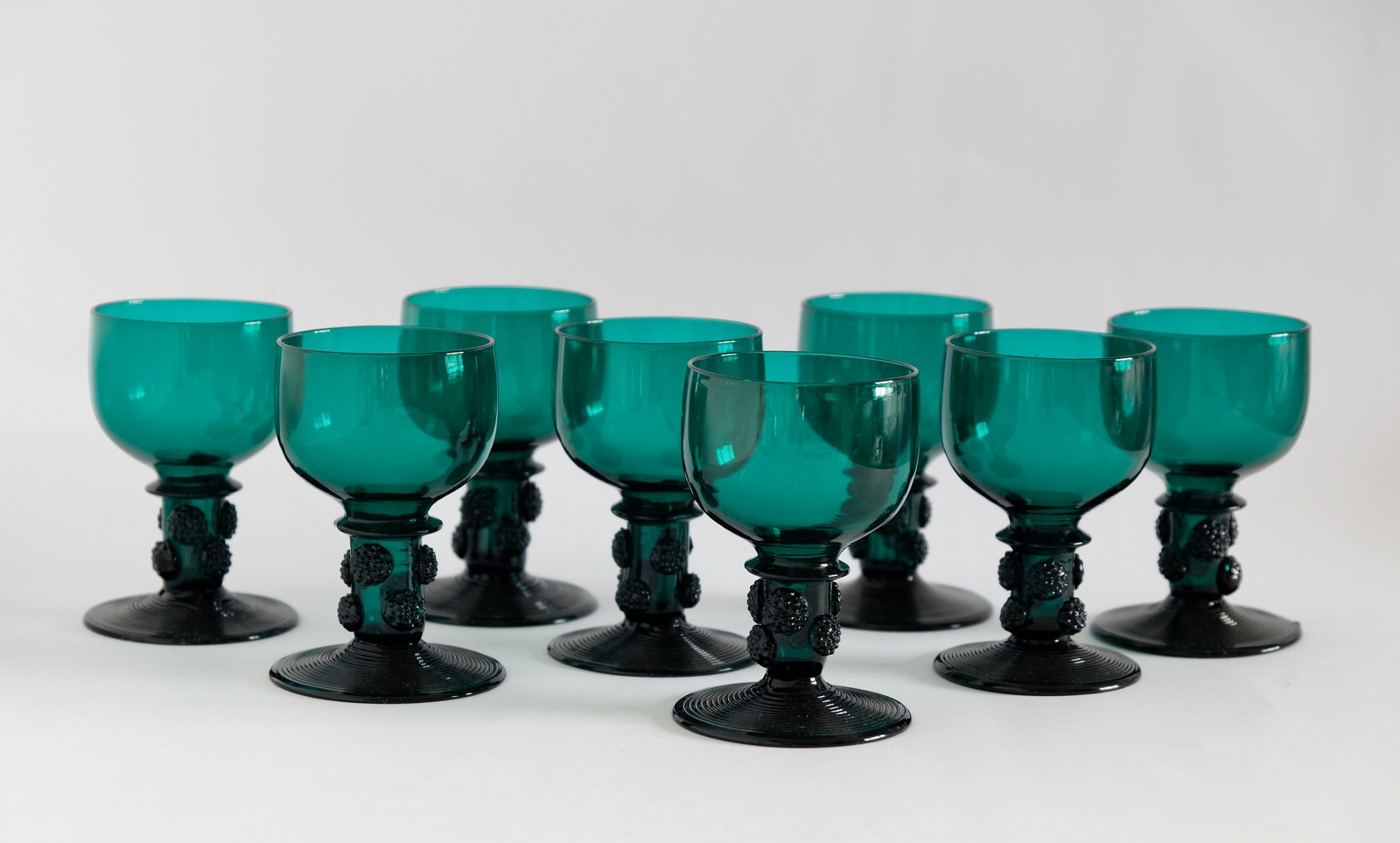 set of eight green wine glasses with raspberry prunts c1830