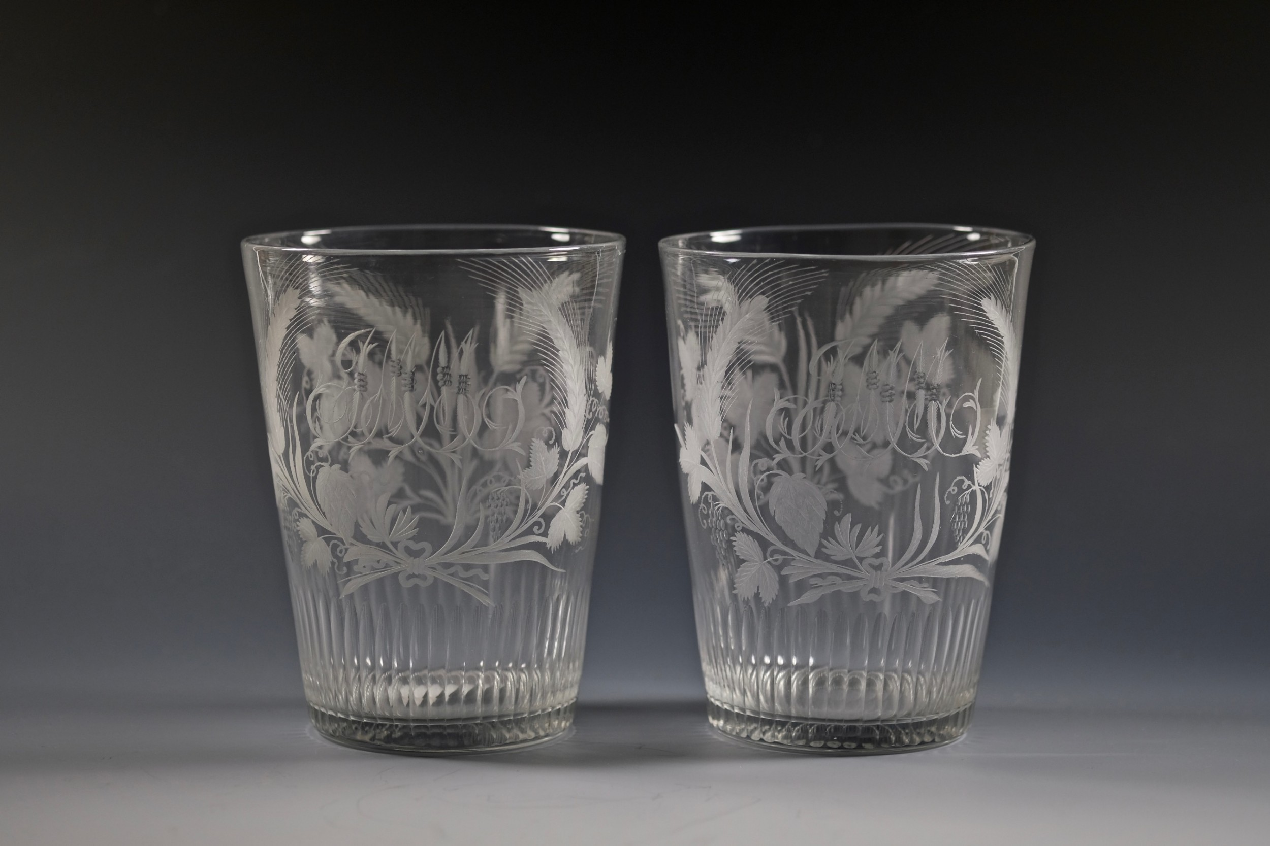 fine pair of large engraved tumblers with basal cut flutes english c1790