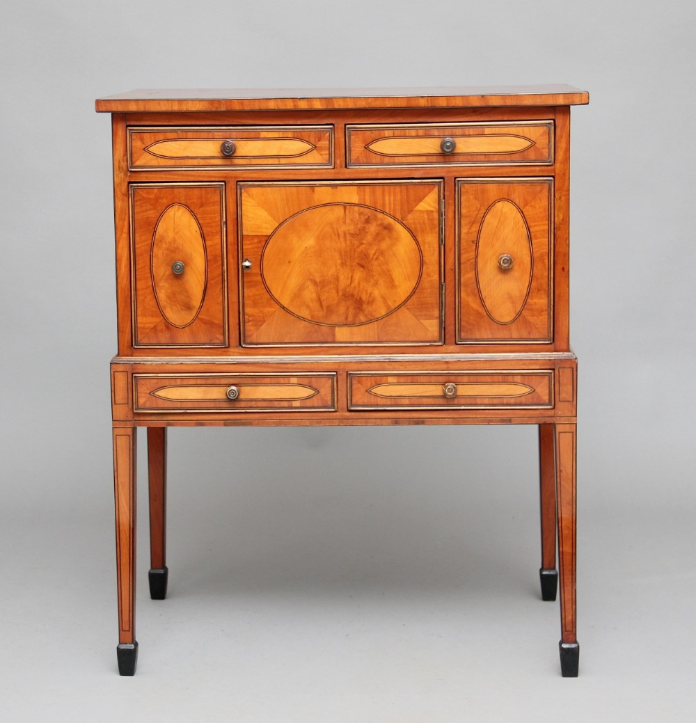 early 19th century satinwood cabinet