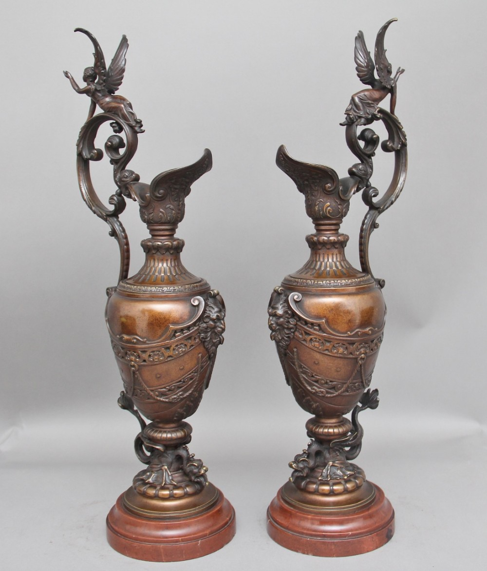 a pair of 19th century bronze and marble ewers