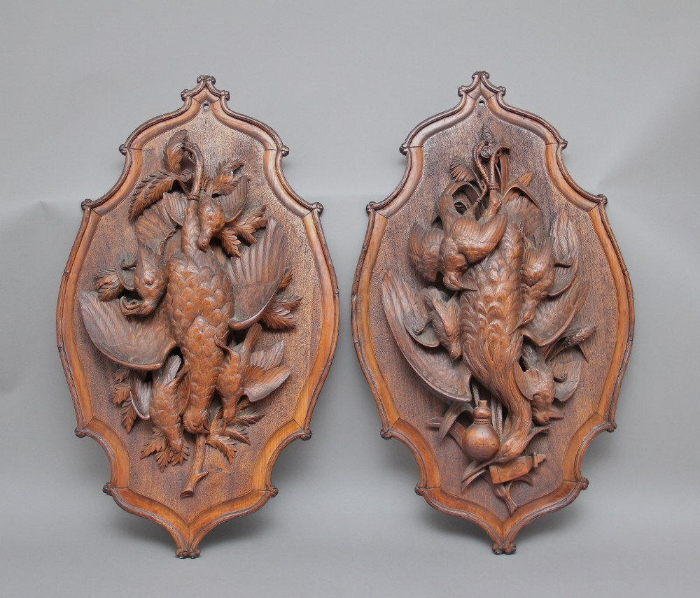 a large pair of 19th century black forest plaques