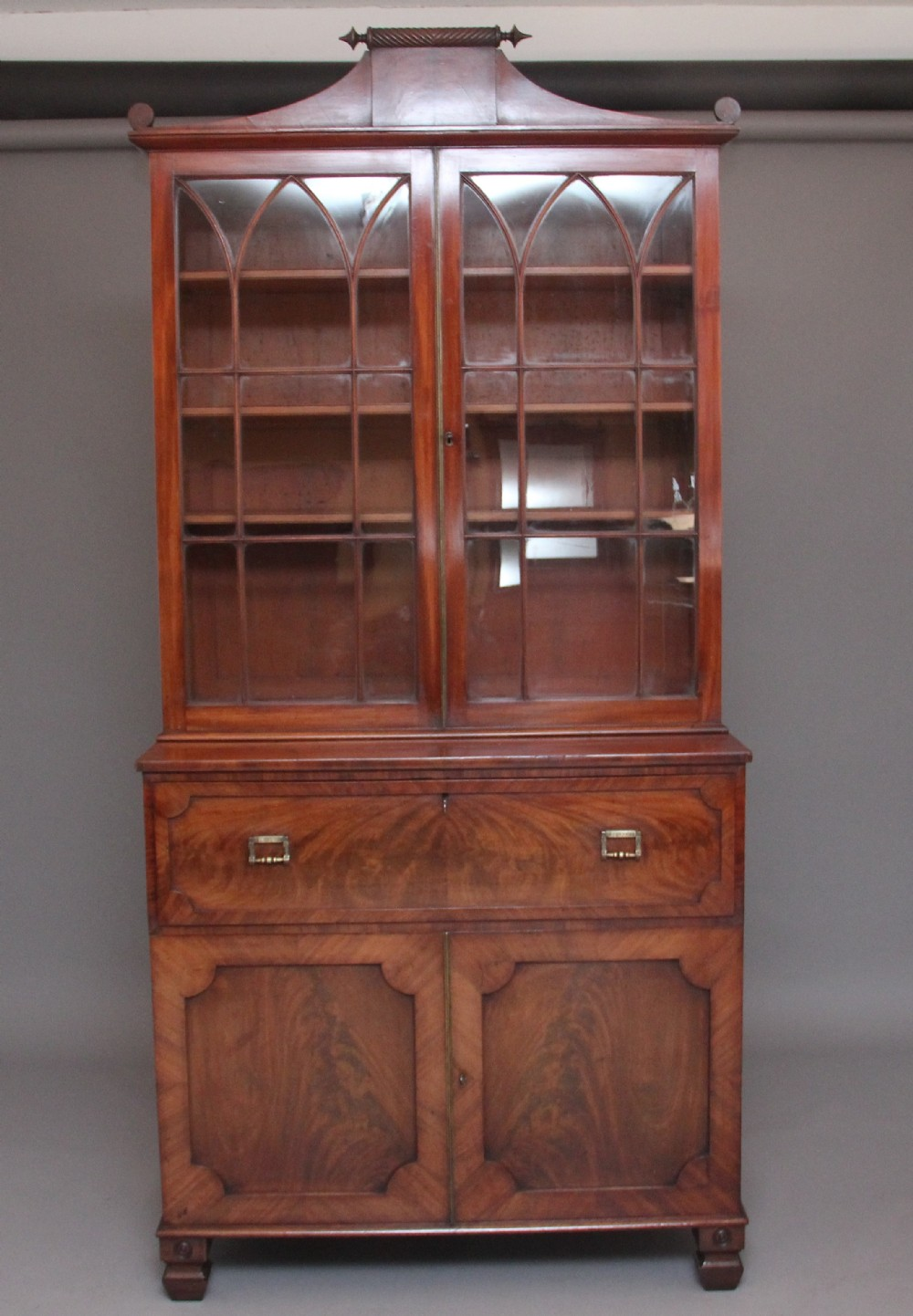 early 19th century flame mahogany secretaire bookcase