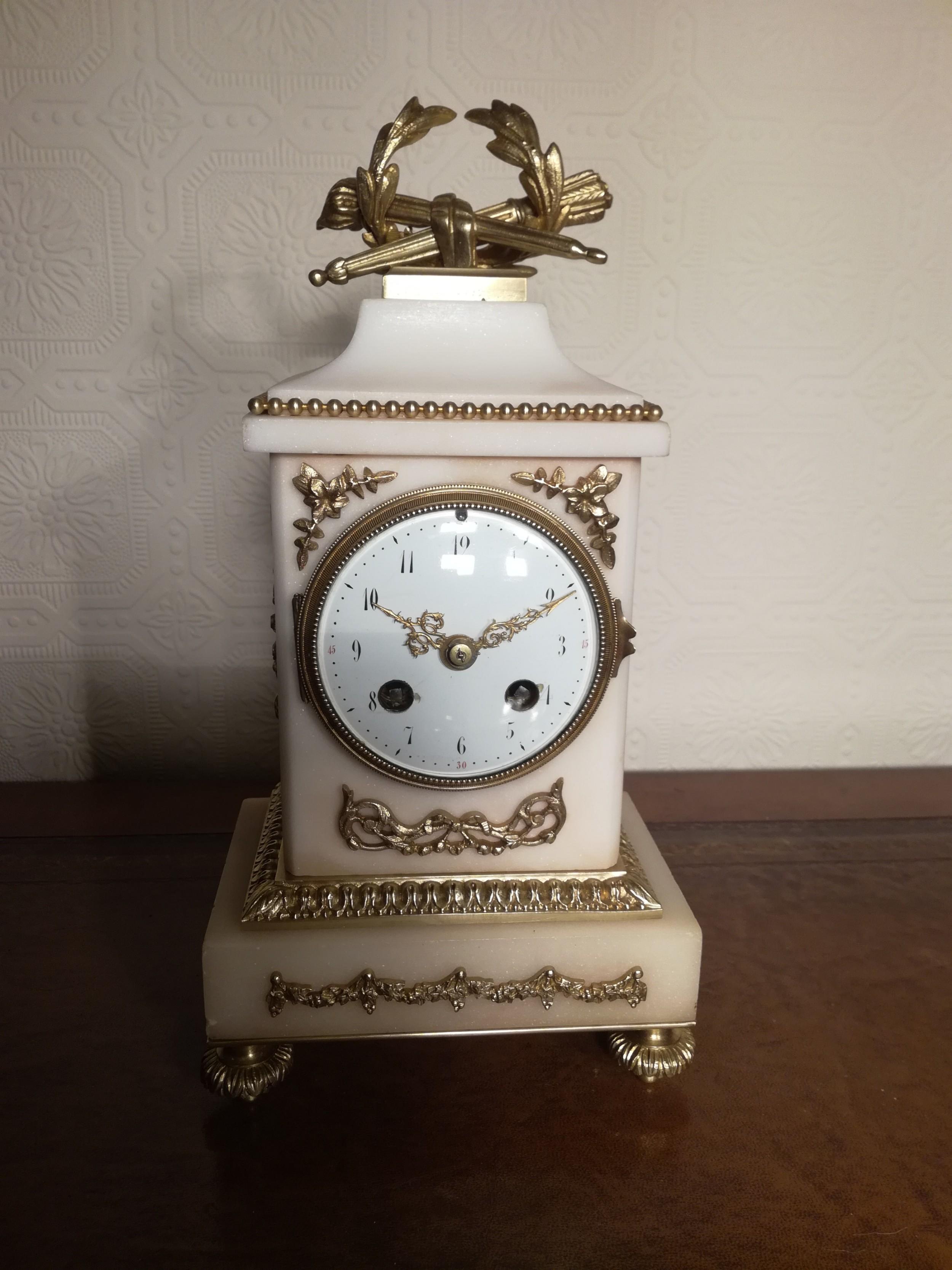 white marble and gilt mantel clock of small proportions