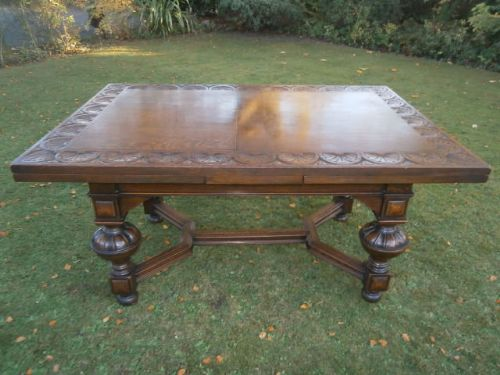 Antique carved oak extending dining table by warings of liverpool 12 seater