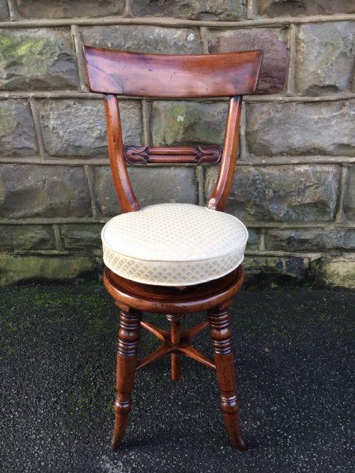 antique mahogany revolving music stool