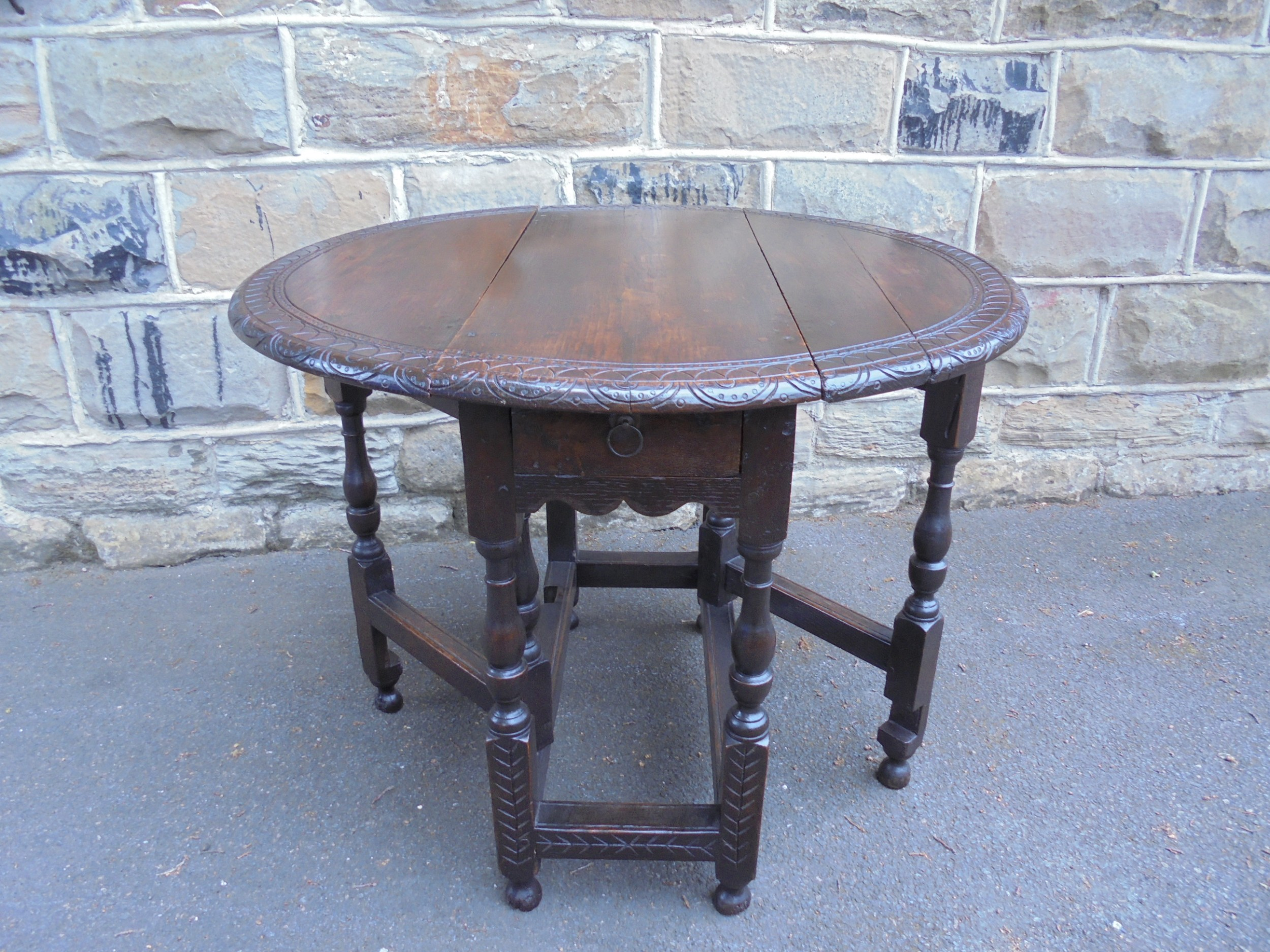 early 18th century country oak drop leaf table