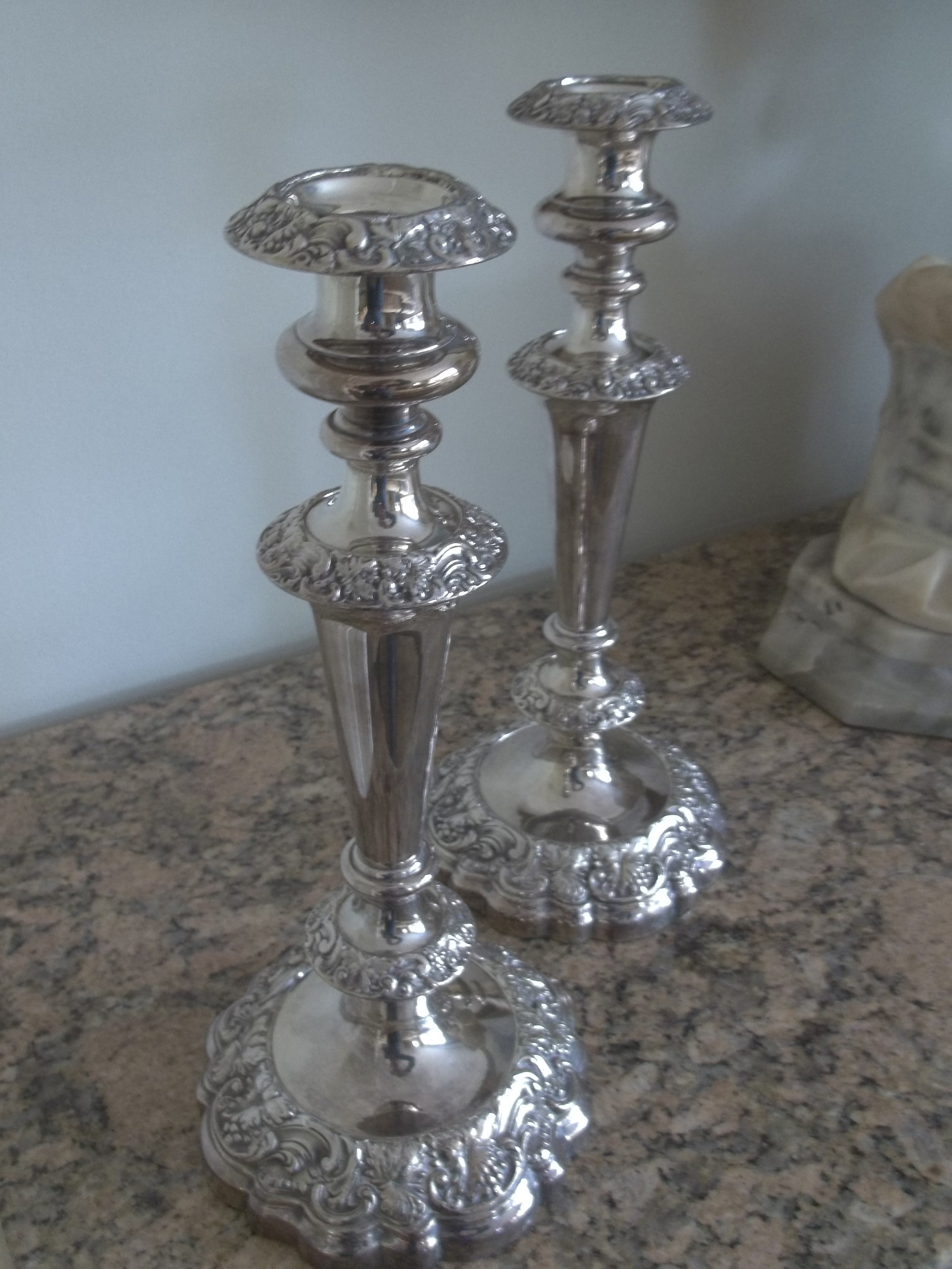 a pair of early sheffield plate candlesticks