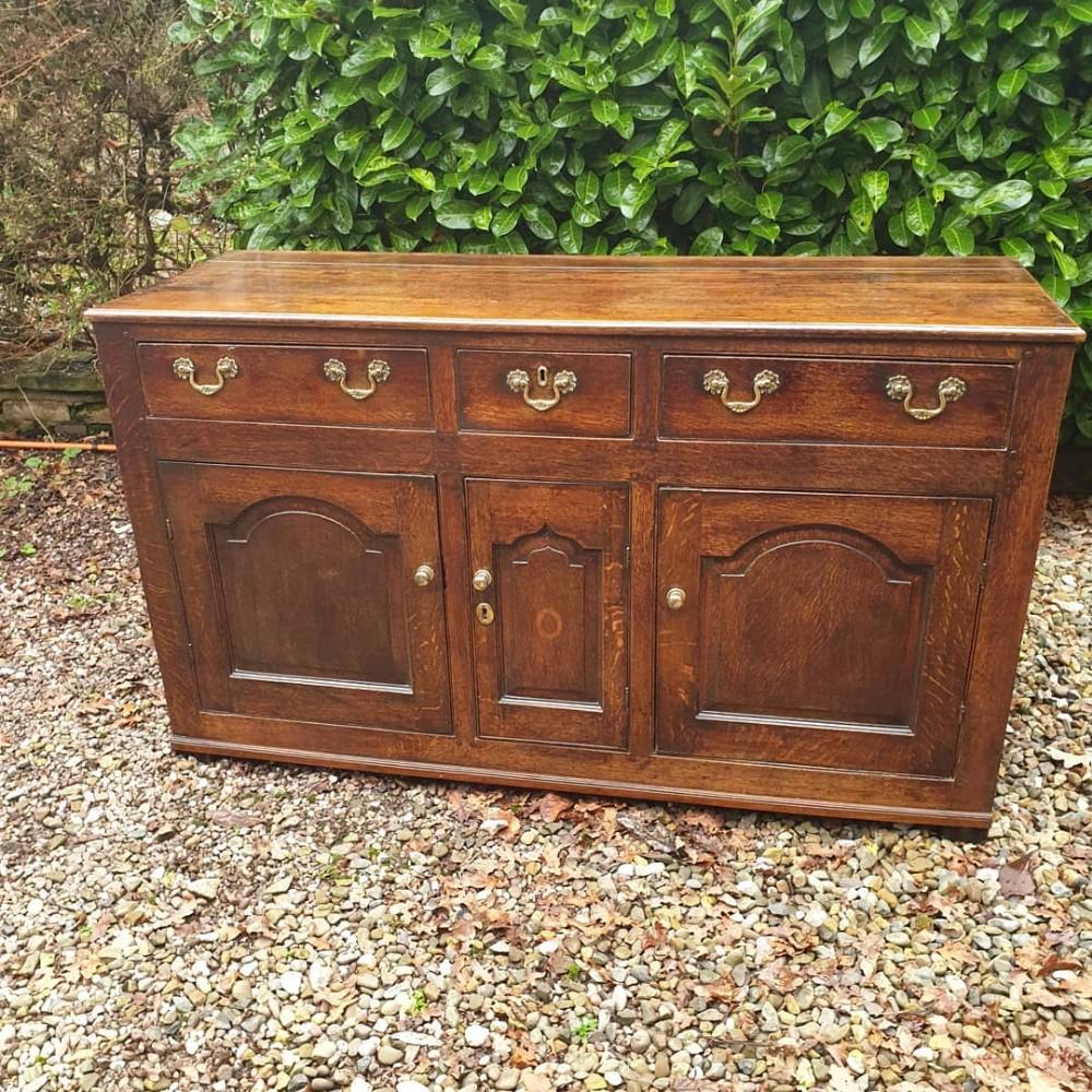 a small mid 18thc oak llanrwst nwales dresser base with3 working cupboards