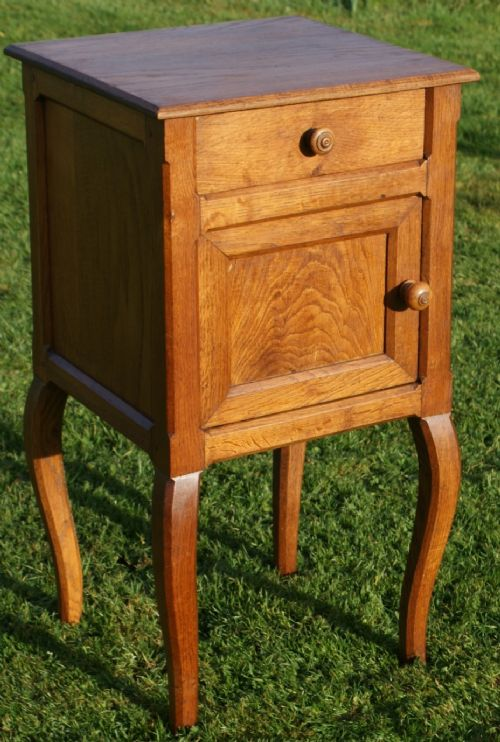 a fine early 20th century french oak louis xv style bedside cabinet