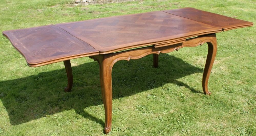 French Oak Parquet Top Louis Xv Style Draw Leaf Dining  : dealermendipantiqueshighres1408980661574 0880048818 from www.sellingantiques.co.uk size 1000 x 533 jpeg 177kB