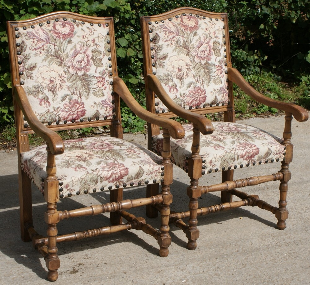 a pair of strong french early 20th century upholstered arm chairs