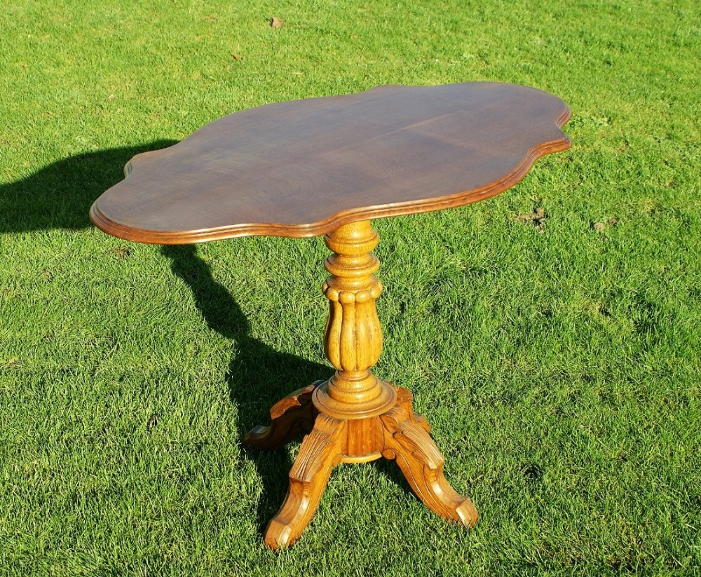 a very pretty late 19th century french oak tilting violin table