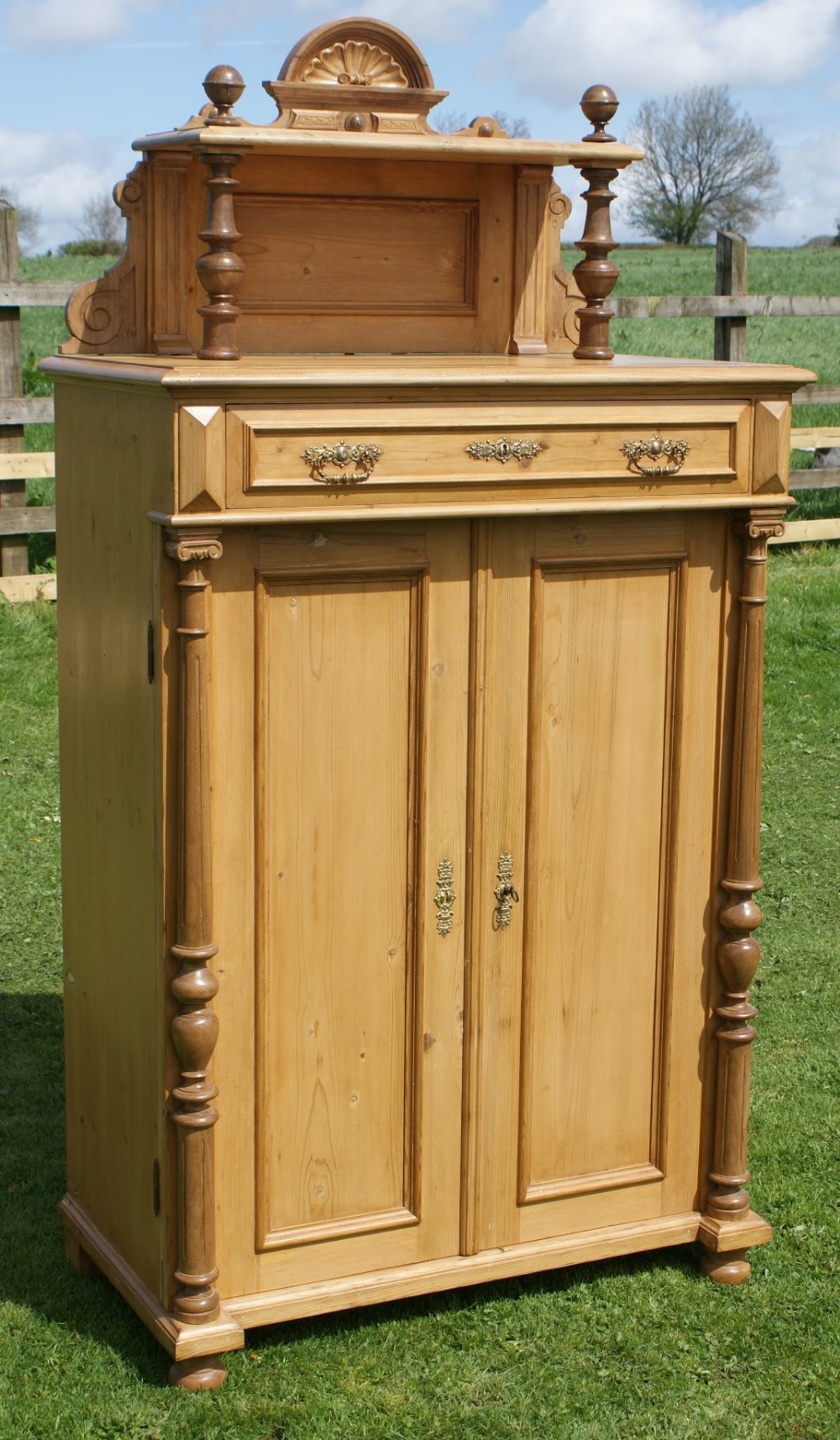 a fantastic antique german stripped pine bonnet cupboard