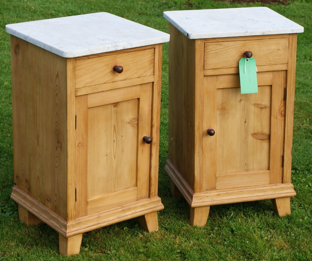 a fine matching pair of antique pine marble top dutch bedside cabinets