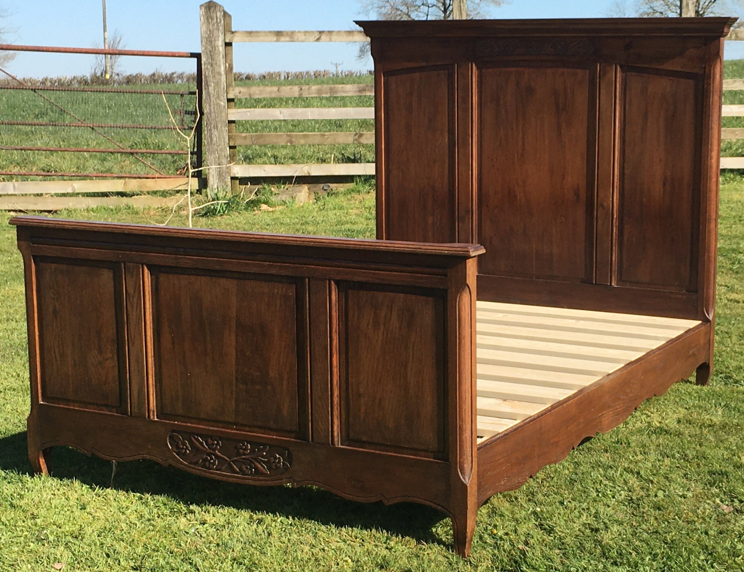 a late 19th century french empire style chestnut double bed with base