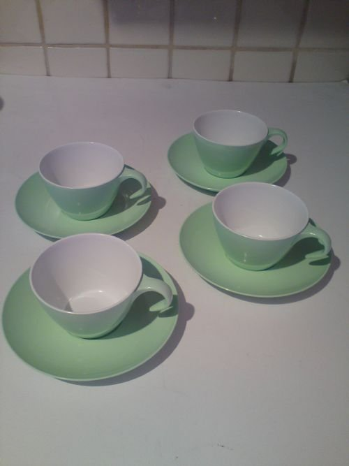 1960's 70's plastic tea cups and saucers