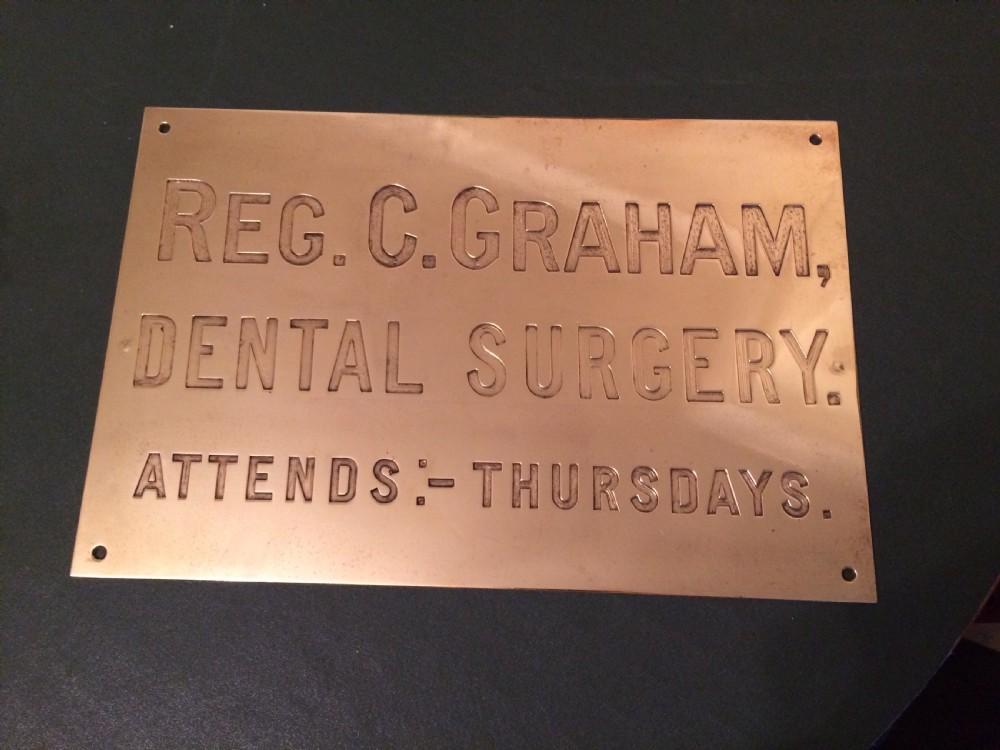 brass dentist surgery sign