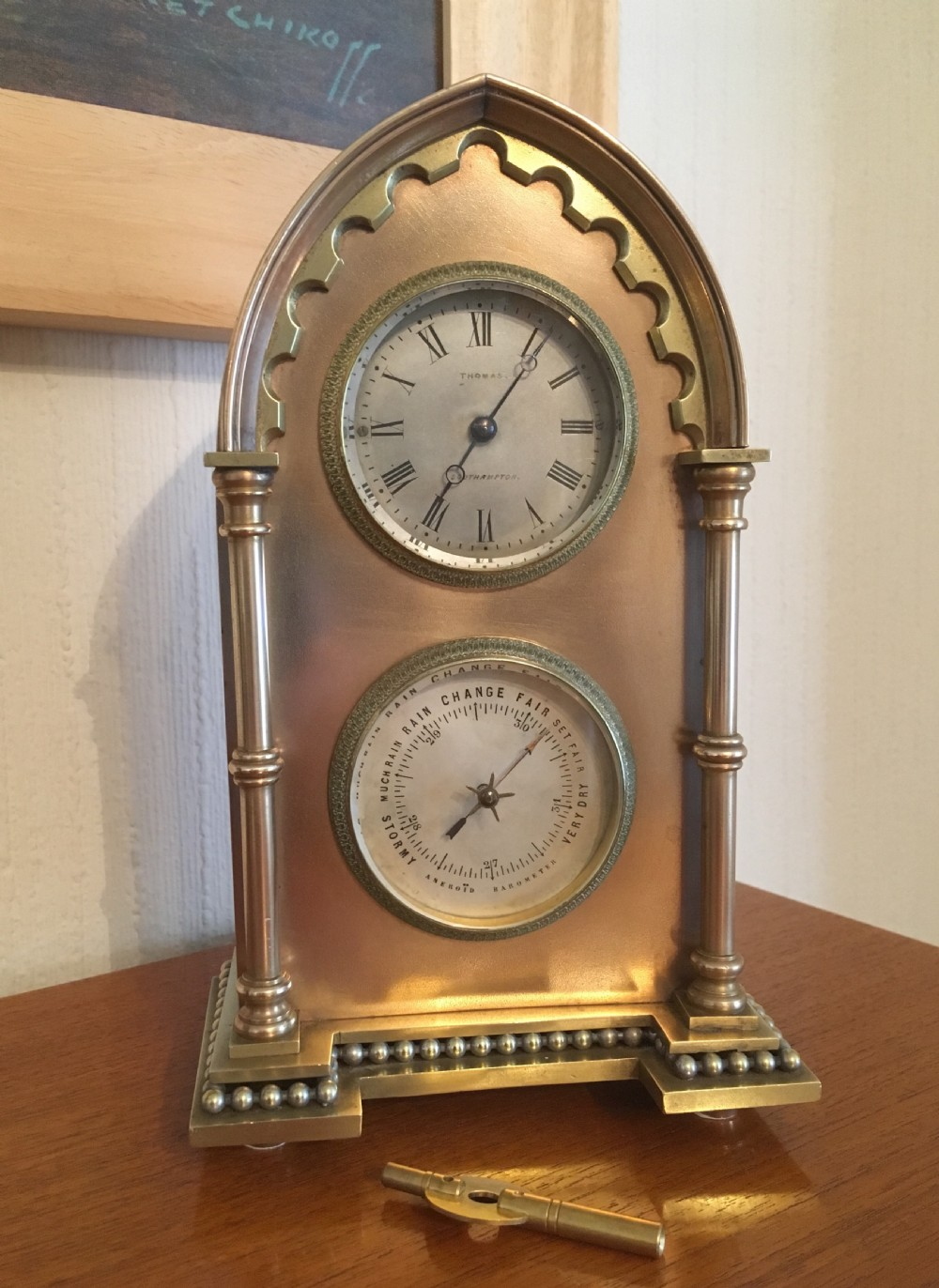 brass and copper cased gothic mantel clock