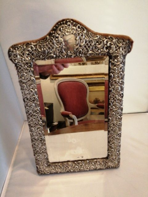 a fine quality silver table mirror