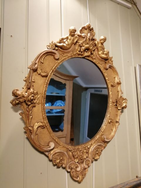 a 19th century giltwood oval mirror