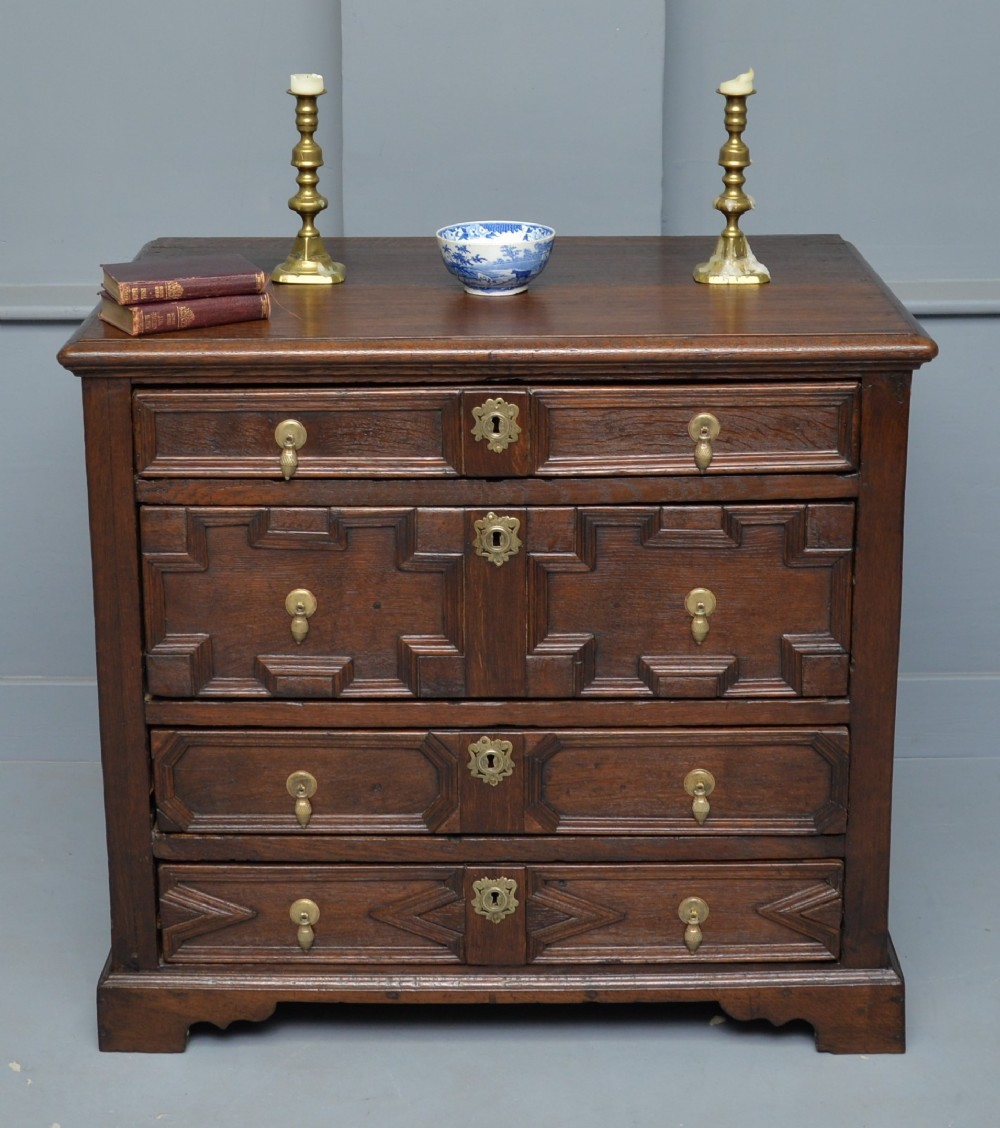 early 18th century geometric oak chest of drawers